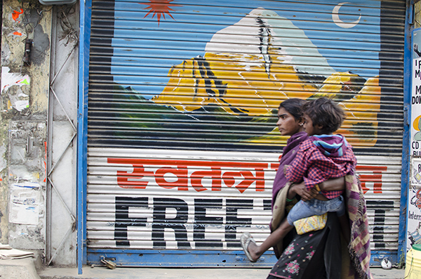 Indian woman and baby with Free Tibet Sign, McLeod Ganj, India