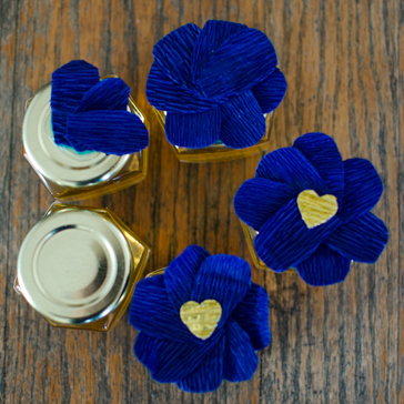 Decorated Honey Jars Part Favors with Crepe Paper Flowers - also good for mason jars!