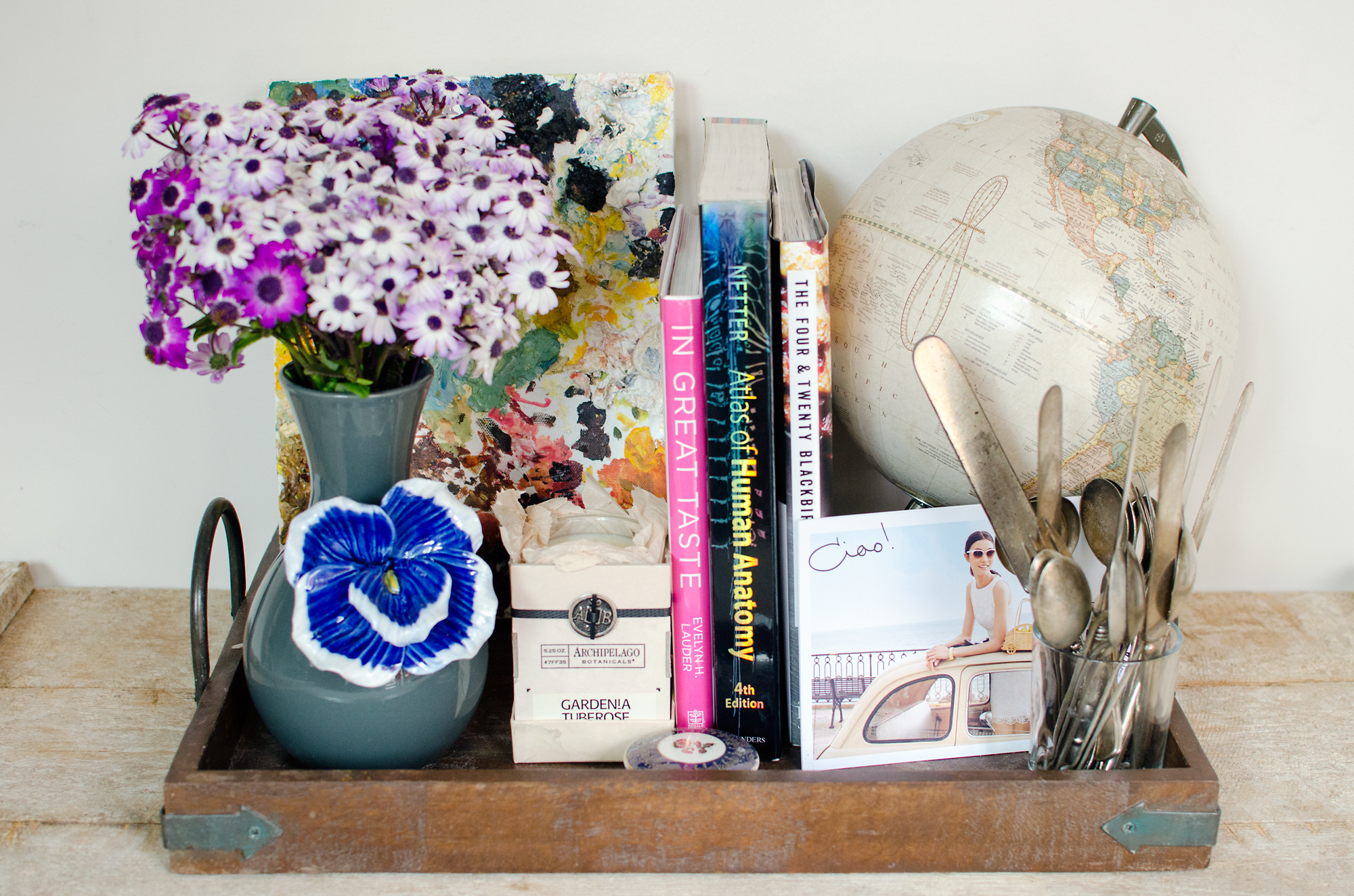 Lovely decorative tray arrangement filled with flea market finds and pretty trinkets.