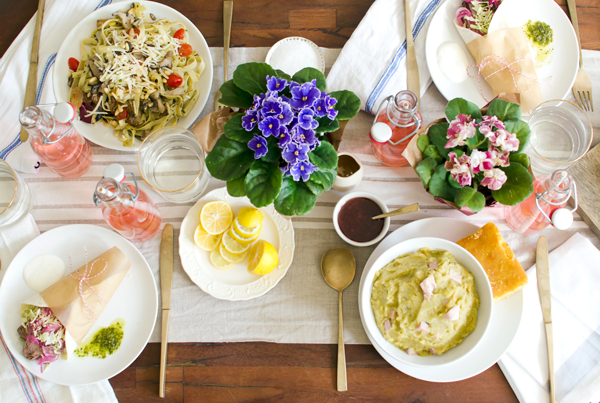 Pretty Tablescape Idea for Dinner Party with Fresh Flowers and Lemons!