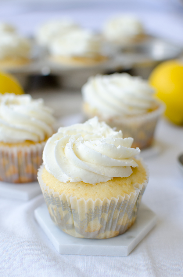 Great idea! Recipe for vanilla cupcakes filled with lemon curd and topped with lemon buttercream!