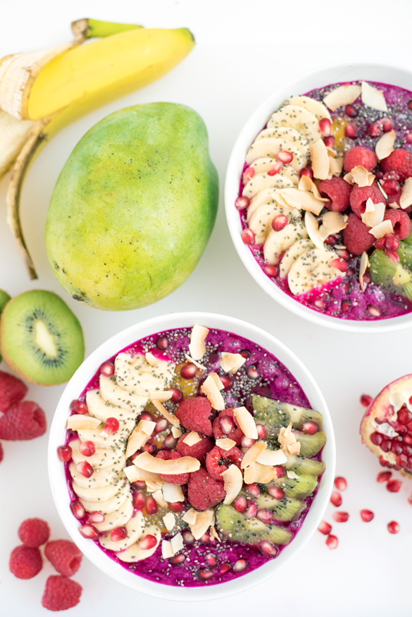 How to make gorgeous pink dragonfruit pitaya smoothie bowls. A healthy vegan and gluten free recipe.