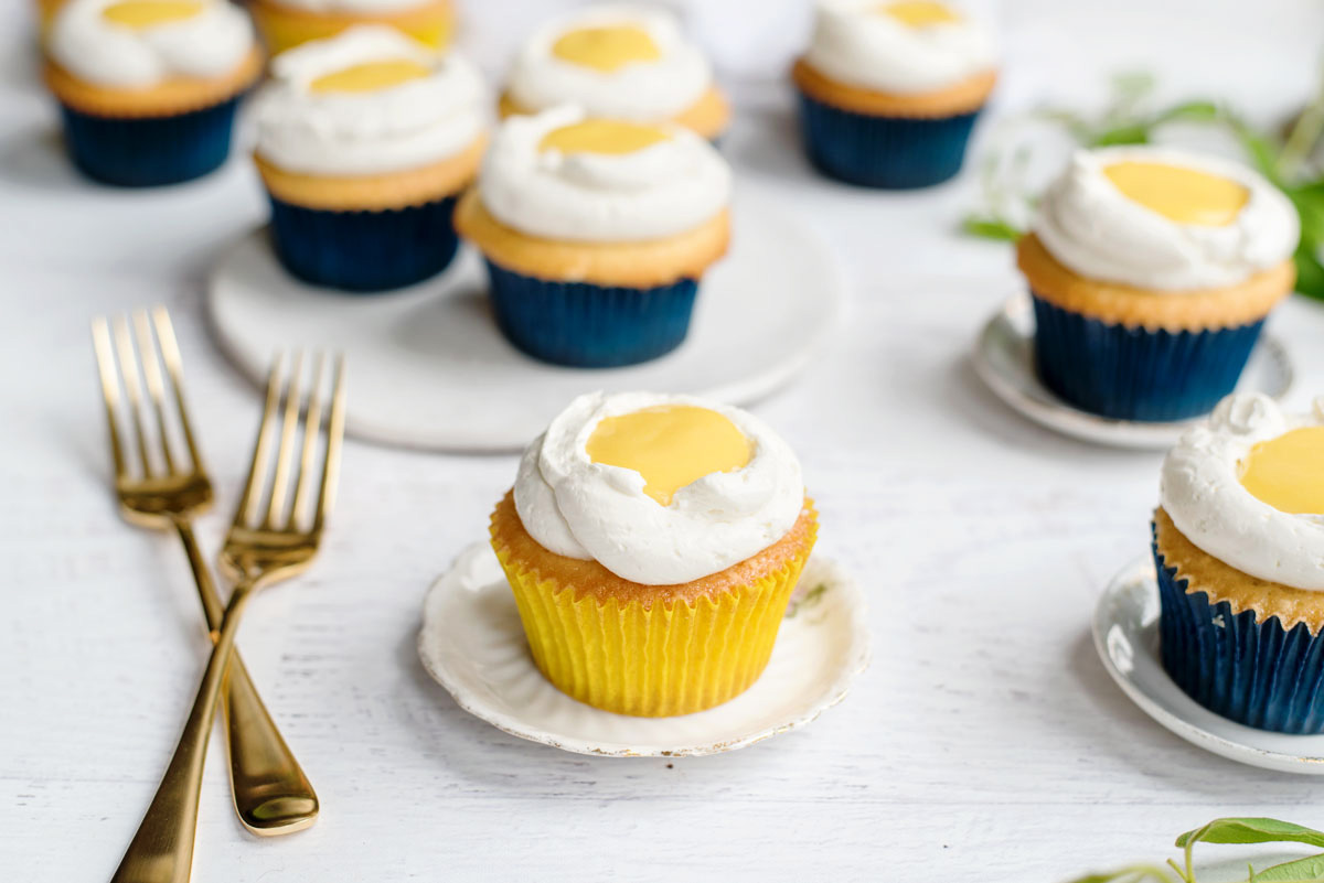 Fun Cupcake Idea - Stuffed Mango Curd Cupcake recipe that looks like Sunny Side Up Eggs!