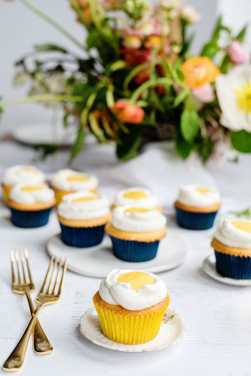 Fun Cupcake Idea - Stuffed Mango Curd Cupcake recipe that looks like Sunny Side Up Eggs!