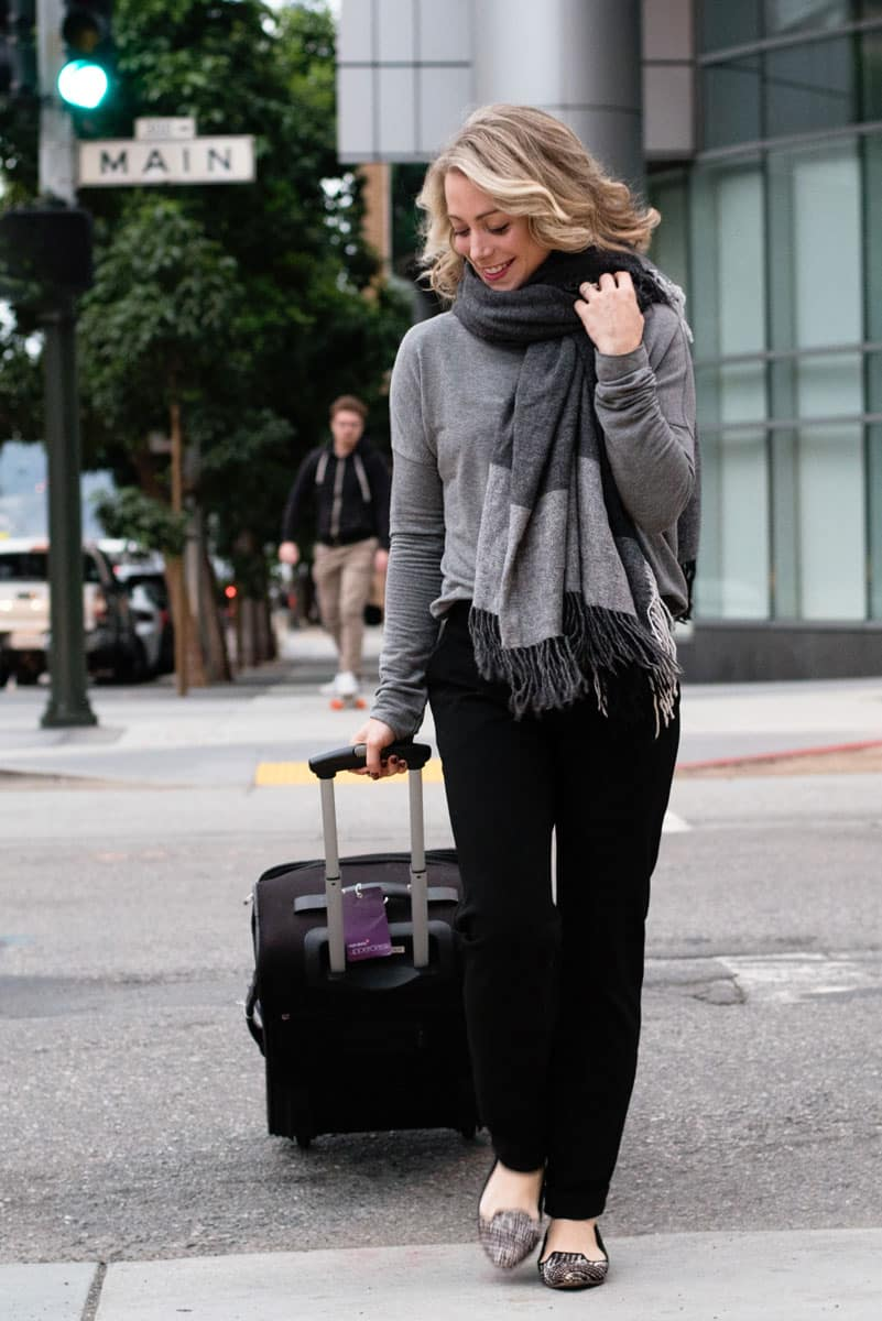 Holiday Travel Style with Luxurious Cashmere Wraps and Stylish Black Pants