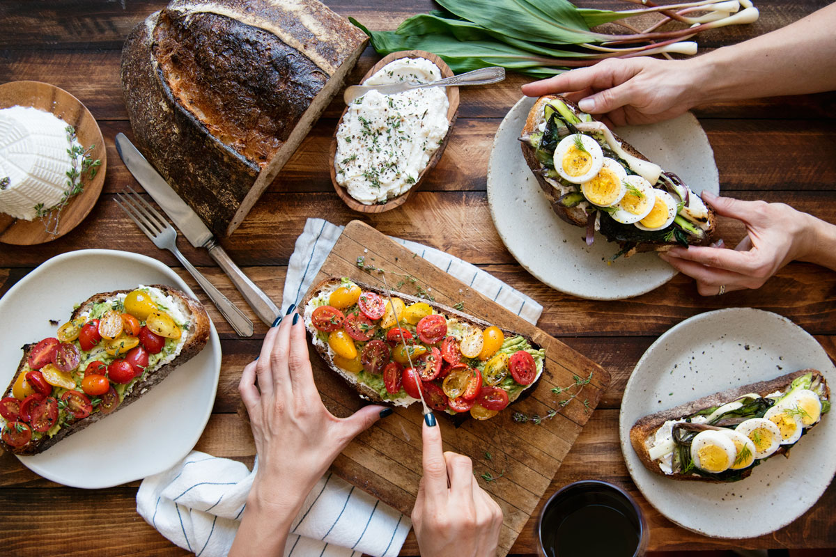 Loaded Avocado Toast Recipe Topped with Tomatoes, Thyme, and Ricotta