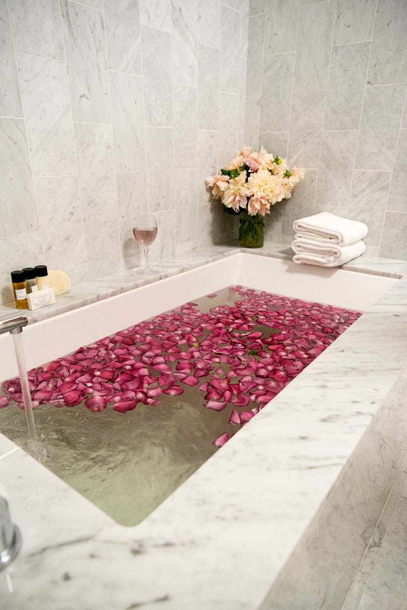 Romantic Bathtub with Rose Petals and Flowers
