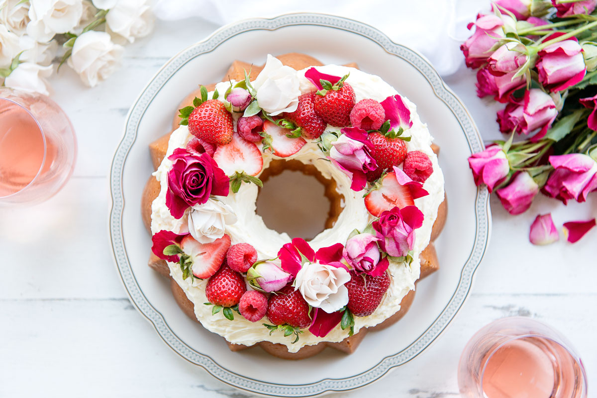Stunning vanilla bundt cake recipe rosewater buttercream edible wedding valentines or birthday cake topped with strawberries fruit flowers and roses izmirmasajfo